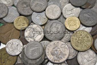 Stack of coins from different countries of the world