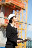 Woman looking at construction site