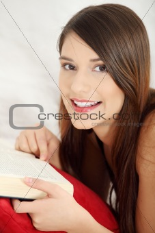 Beautiful woman reading a book