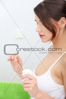 Beautiful young woman holding dental floss