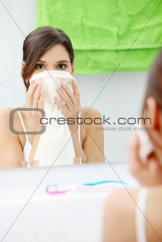 Beautiful woman wipes her face
