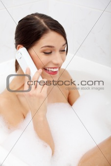 Beautiful young woman talking by phone