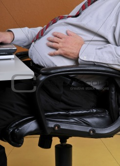 Man holding his bloated stomach