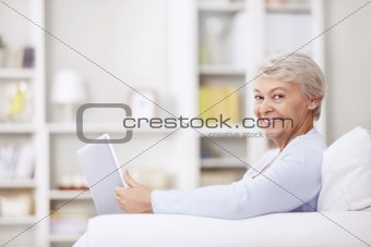 Smiling elderly woman at home