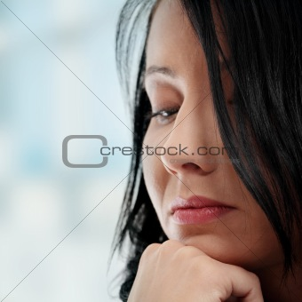 A worried and afraid young woman