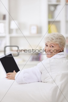 A smiling woman with a laptop