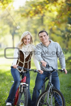 Young couple on bikes