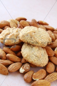 Amaretti macaroons on almond background
