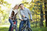 Attractive couple on bikes