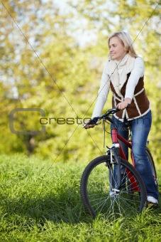 Beautiful girl on a bike