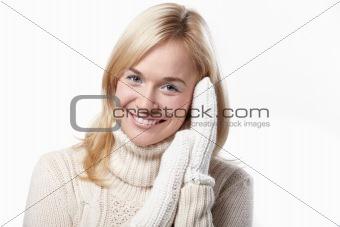 Attractive girl in mittens