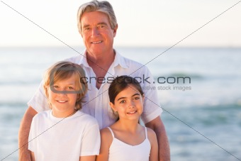 Portrait of a Grandfather with their grandchildren
