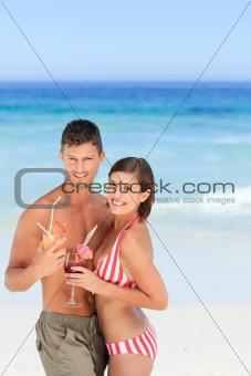 Adorable couple drinking a cocktail