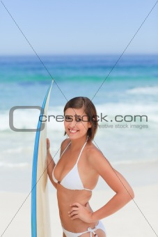 Cute woman with her surfboard