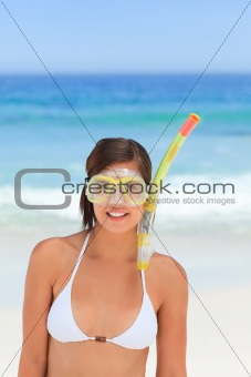 Woman with her mask at the beach