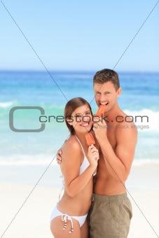 Lovers eating an ice cream