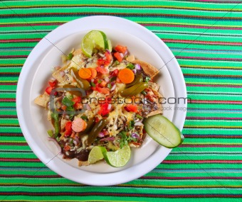 Nachos with cheese vegetables chili Mexico