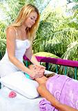 Caribbean facial massage therapy blond woman