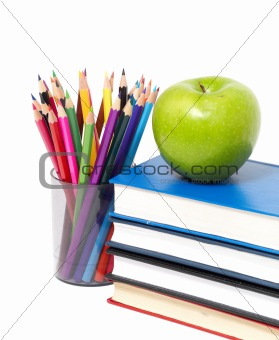 apple, books and colored pencil