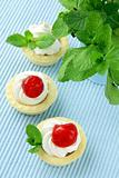 dessert tartlets with cream, mint and cherry