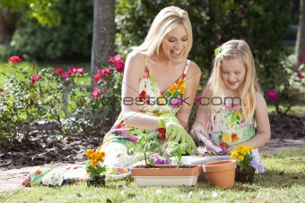 Woman and Girl, Mother &amp; Daughter, Gardening Planting Flowers