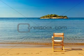 Chair on sandy beach