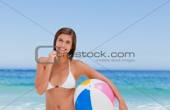 Cute woman with her ball on the beach