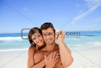 Lovers listening to their shell
