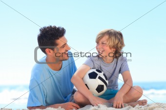 Father and his son with a ball
