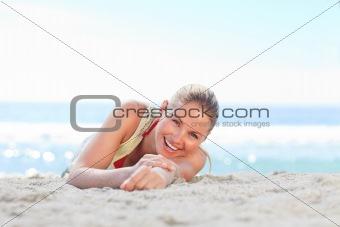 A woman sunbathing on the beach