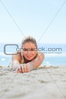 A woman sunbathing at the beach