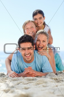 Portrait of a smiling famiy at the beach