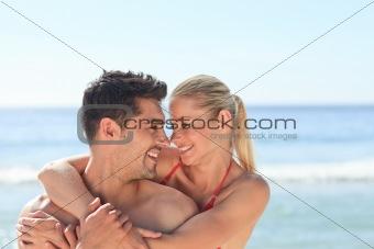 Joyful couple at the beach