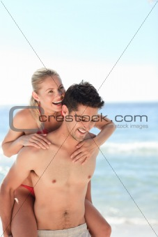 Beautiful man having girlfriend a piggyback