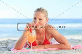 Cute woman drinking a cocktail
