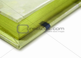 Close up of a green colored journal on white