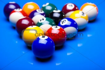 Billiard balls isolated on blue