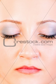 Portrait of beautiful woman with close eyes