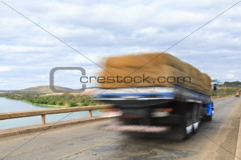 Cargo truck over bridge