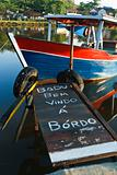 Board ramp to wooden boat