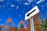 Road sign and fall colors