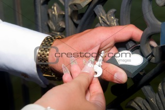 groom holds the key