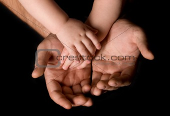 Man and child's hand