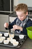 Kid Filling Cake cups With Dough