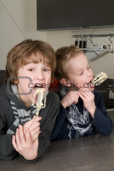 Boys Eating Dough From A Beater