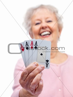 Pretty senior lady holding playing cards