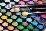 eyeshadow kit with three makeup brushes
