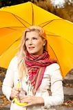 young pretty woman with autumn umbrella