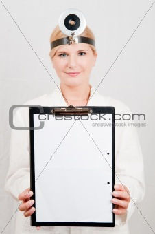 young female doctor or nurse making notes