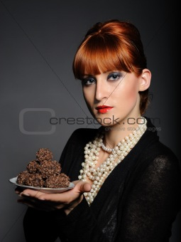 Beautiful elegant fashion woman with chocolate truffle sweets